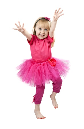 little blonde girl: little girl in a pink dress dancing in studio isolated on a white background Stock Photo
