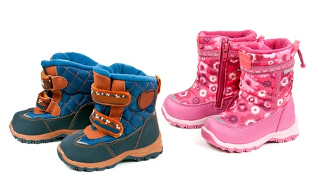 Two pairs of baby blue and pink boots isolated on white background photo