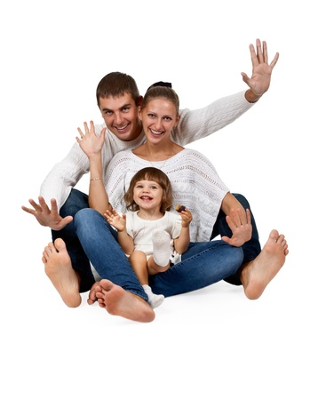 father, mother, daughter, sitting in the studio on a white background photo