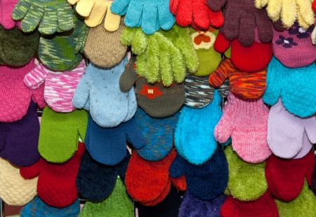 mitten: showcase childrens mittens and gloves colored background Stock Photo