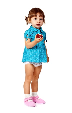 little girl eating an apple on a white background photo