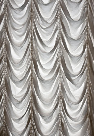 White curtains draped theater in the background Stock Photo