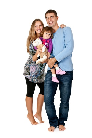 little girl barefoot: happy father, mother and daughter in the studio barefoot on a white background