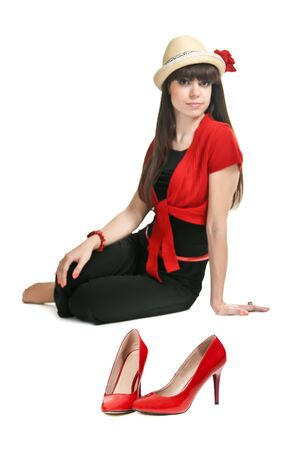 Beautiful girl on the background of a pair of red women's shoes Stock Photo - 10767813