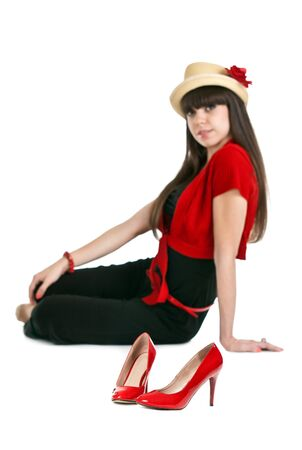 Beautiful girl on the background of a pair of red women's shoes Stock Photo - 10767824