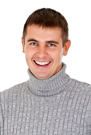 portrait of beautiful smiling man in a gray striped sweater Stock Photo