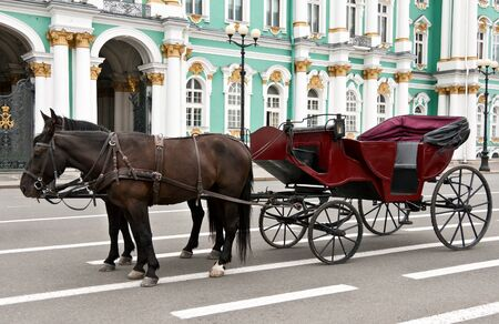 carriage with horses in the background of the Hermitage, St. Petersburg, Russia photo