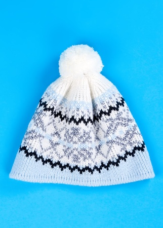 knitten: knitted wool hat with the pattern on a blue background