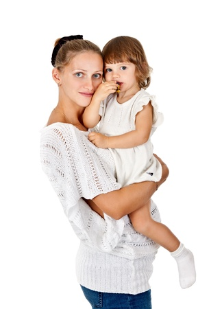 Pregnant mother and daughter to eat a plum on a white background photo