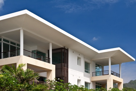 modern house on a background of blue sky and palm trees