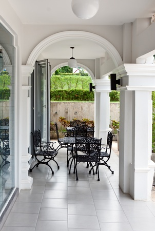 terrace with wrought tables and chairs photo
