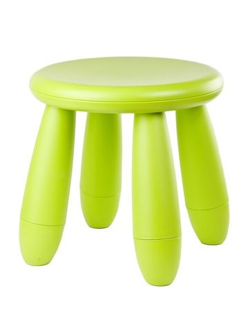 escabeau: selles b�b� en plastique vert sur un fond blanc