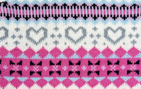 knitted colored background with a pattern in the shape of heart photo