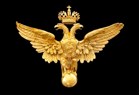 royal background: gold double eagle isolated on a black background Editorial