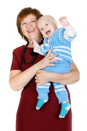 grandmother with her grandson in her arms in the studio on a white background photo