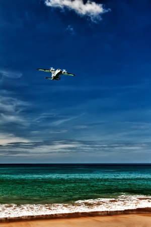 propeller aircraft comes in to land on the beach photo