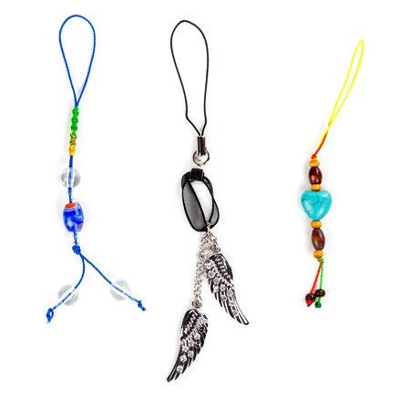 Three pendants jewelry isolated on white background photo