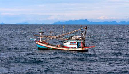 schooner: Thai fishing schooner at sea in bad weather conditions