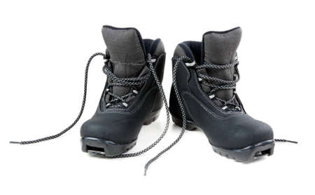 A pair of cross country ski boots isolated on white background photo