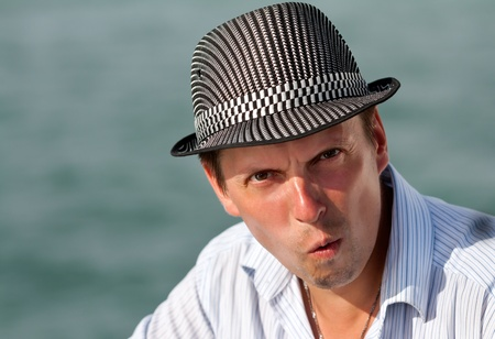 portrait of a man in a hat amazed at the background of the azure sea Stock Photo - 12944443