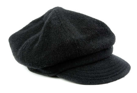 knitten: Warm black womens cap in the studio on a white background