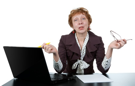 middle-aged woman at a computer on a white background photo