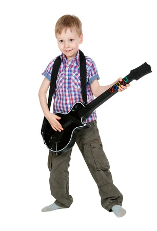 The boy with the electronic guitar isolated on white background photo