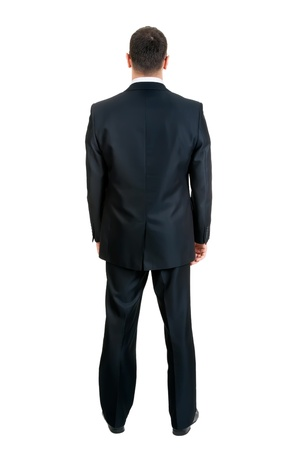 straight man: Businessman standing with his back to the studio, isolated on white