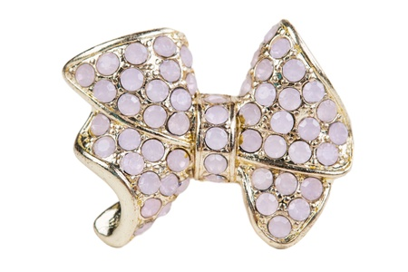 Brooch in the shape of a bow adorned with stones photo