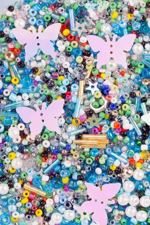 background of jewelry with plastic butterflies photo