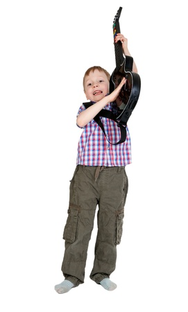 The boy with the electronic guitar isolated on white background Stock Photo - 13229507