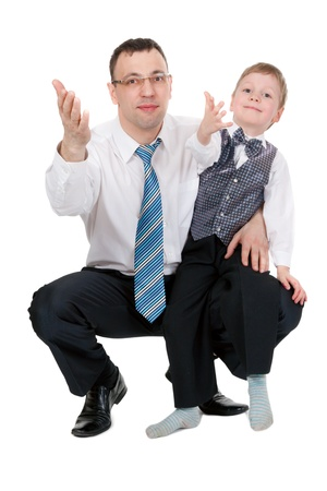 businessman and his son pulled his hands in the studio, isolate on white photo