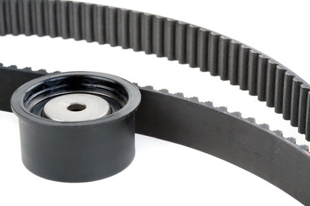 tension pulley and timing belt, Isolate on white photo