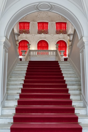 staircase, the entrance to the palace with the red carpet