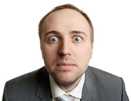Crazy businessman making funny faces, isolat on white Stock Photo - 13609933