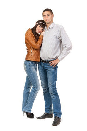 Full length of attractive Caucasian couple standing together on white background Stock Photo - 13636238