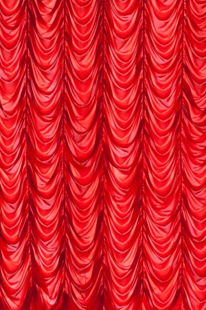 Brightly  red lit curtains for your background photo