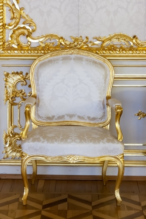 Elegant antique chair decorated with gold leaf in the Palace's Central