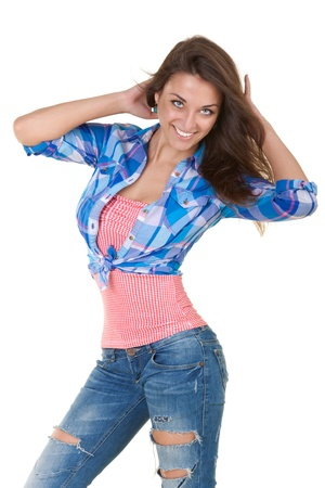 glamor girl in torn jeans on a white background photo