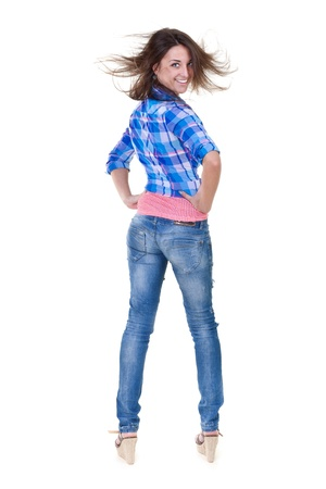 Beautiful girl in jeans turns out to back on a white background Stock Photo - 13842478
