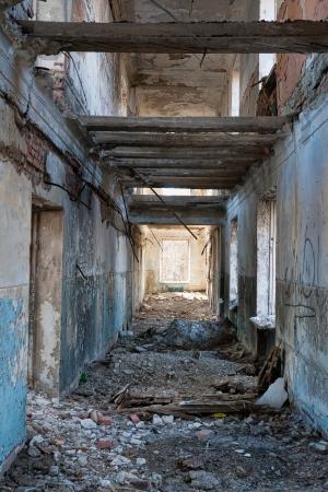 devastation: corridor in an old abandoned building