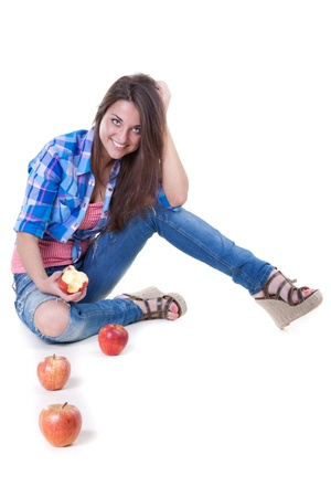 beautiful young woman in jeans with the apples in the studio on a white background photo