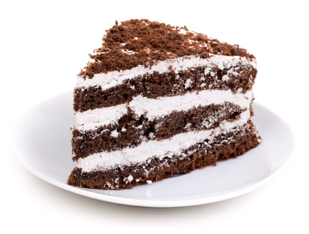 Slice of chocolate cake stuffed with whipped cream and white chocolate on white background