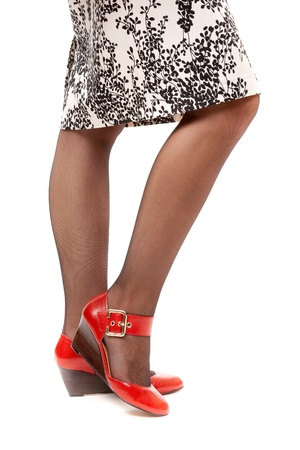 Sexy legs in red shoes and pantyhose Stock Photo - 14427165