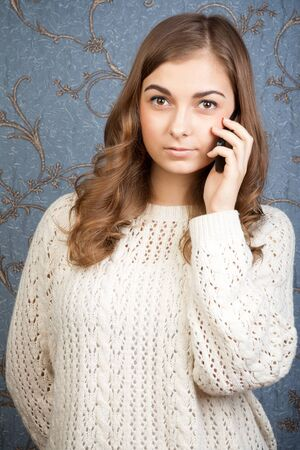 18's: portrait of young woman talking using a telephone against a vintage background