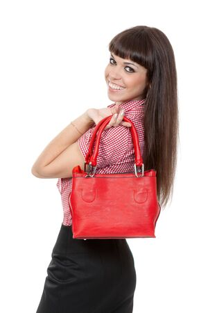 Portrait of a girl with a fashionable red handbag. Isolate on white. photo