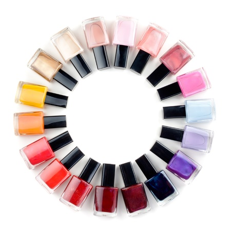 fangle: Coloured nail polish bottles stacked circle on a white background