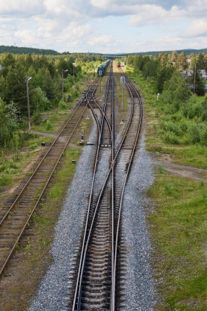 Railroad tracks, isolation and trains on the road against the backdrop of nature photo