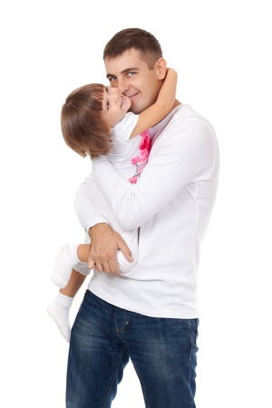 Dad kissing his little daughter, isolated on white photo