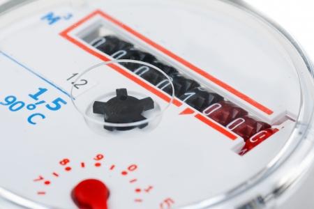 metro medir: medidor de agua close-up aislados en fondo blanco Foto de archivo